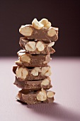 Several pieces of hazelnut chocolate, stacked