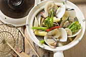 Shellfish with baby corn and wild broccoli (Asia)