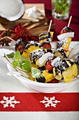 Exotic fruit skewers with coconut and chocolate