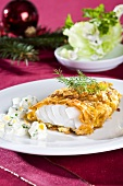 Fish fillet in cornflake coating with remoulade (Christmas)