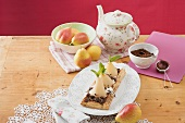 Puff pastry pear tart with grated chocolate, teapot