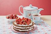 Strawberry cream cake with coffee