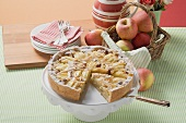 Apple tart with flaked almonds, a piece cut