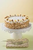Apple and walnut cake on cake stand
