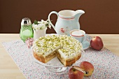 Apple cake with cream and pistachios, coffee, fresh apples