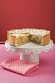 Apple pie, a piece cut, on cake stand