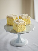 Vanilla and coconut squares on cake stand