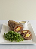 Beef roulade filled with egg, rocket salad