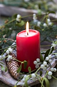 Christmas decoration with burning candle