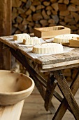 Farmhouse butter and various wooden moulds on wooden table