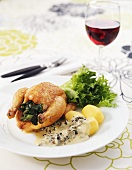 Roast chicken with boiled potatoes and morel sauce