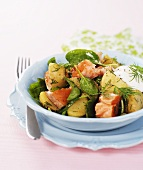 Warm potato salad with salmon, spinach, dill, sour cream