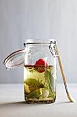 Herbal oil in a preserving jar