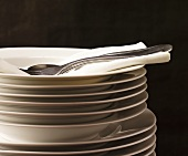 Stacked plates with napkin and cutlery
