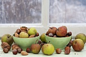 Apples, almonds and nuts on a windowsill
