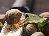 Nutmegs with grater and bay leaves