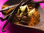 Spices for baking (vanilla pods, cardamom and cloves)