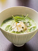 Spinach soup with garlic and coconut chips