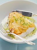 Catfish with crispy potato crust on dill cucumber with lemon sauce