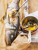 Sea bass in paper with fennel and lavender flowers