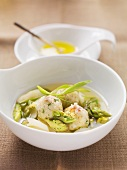 Clear asparagus soup with ham dumplings and tarragon