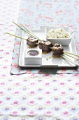 Oriental lemongrass and beef kebabs with noodles and a dip