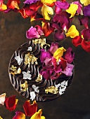 Chocolate with gold leaf and rose petals