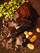 Pieces of chocolate, nuts and cocoa powder