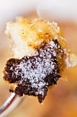 Kaiserschmarren (shredded sugared pancake from Austria) on a fork