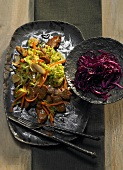 Game ragout with savoy cabbage and red cabbage