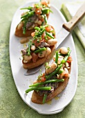 Baguette slices topped with bean salad