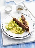 Minced meat kebabs with cooked cucumbers