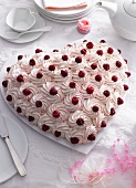 A heart-shaped raspberry tart