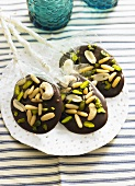 Chocolate lollies with pine nuts and pistachios