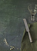 Bread curmbs, serviette, knife and a wine glass