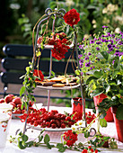 Tiered stand with cherries, biscuits and verbena flowers