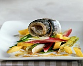 Steamed sea bass with spring onions and mango