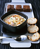 Scallop and vegetable stew with crackers and brownies