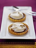 Orange marmalade tarts with meringue