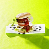 Burger on napkin with football motif