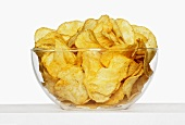 Glass bowl of crisps