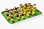 Cheese on cocktail sticks with flags of Poland and Germany