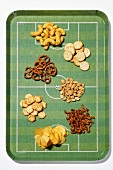 Nibbles on football pitch tray