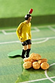 Tipp kick figure with peanuts