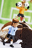 Chocolate cake with footballer and goalkeeper