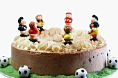 Chocolate cake with footballers
