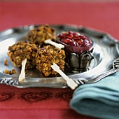 Chicken with nut crust and pomegranate dip