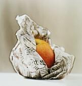 Apple in newspaper