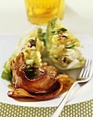 Slices of glazed belly pork with lettuce