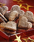 Heart-shaped cinnamon biscuits with jam filling